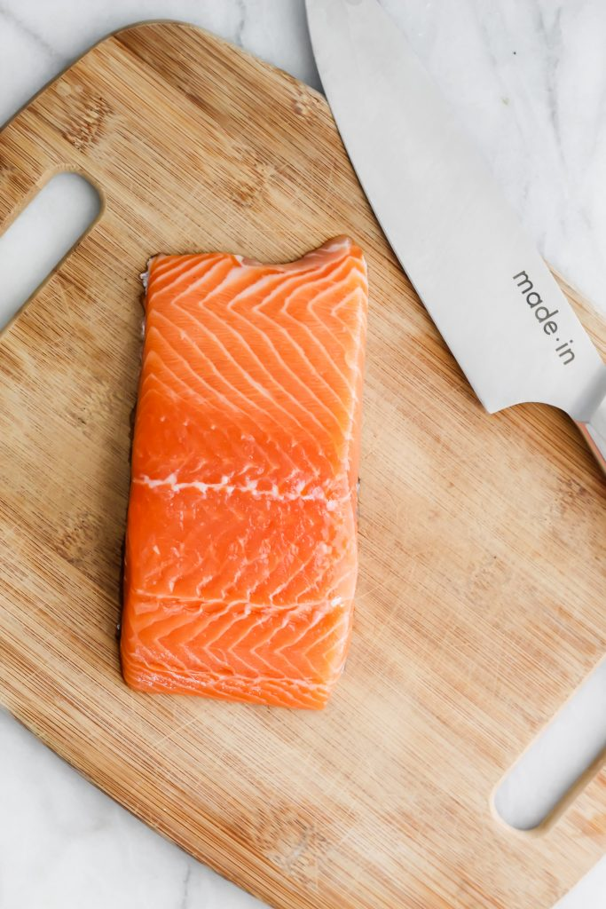 fresh salmon filet with made in knife