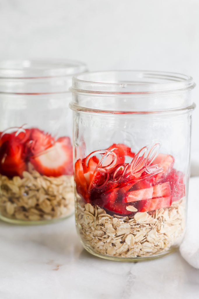 mason jars with oats and strawberries