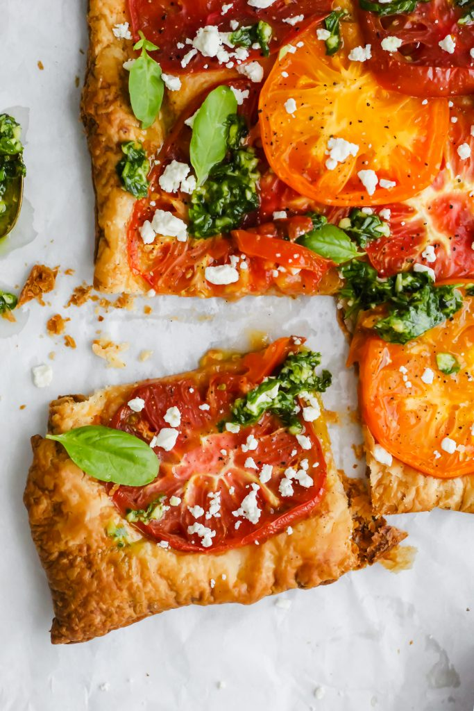 close up of one slice of Heirloom Tomato Tart with Basil Sauce