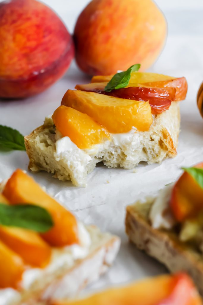 Whipped Ricotta Toast with Roasted Peaches with bite taken