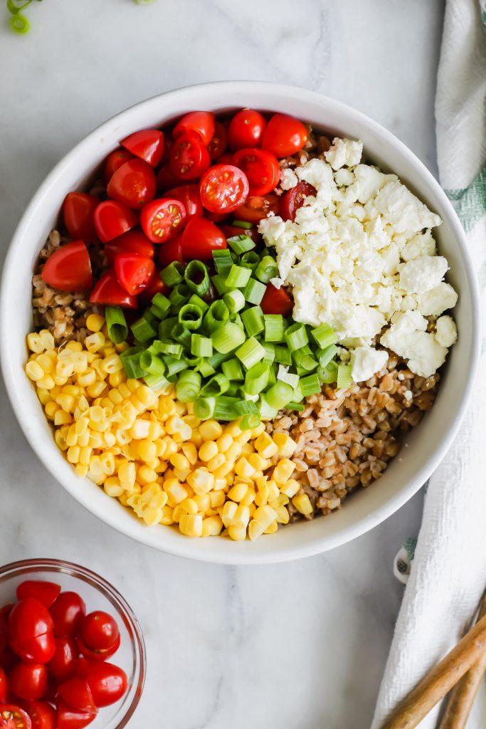 Summer Vegetable Farro Salad ingredients in bowl overhead shot