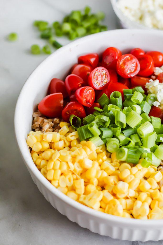 Summer Vegetable Farro Salad ingredients in bowl