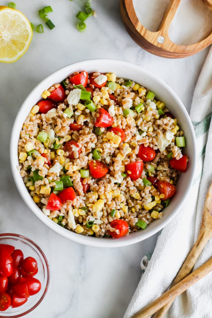 Summer Vegetable Farro Salad mixed in white bowl
