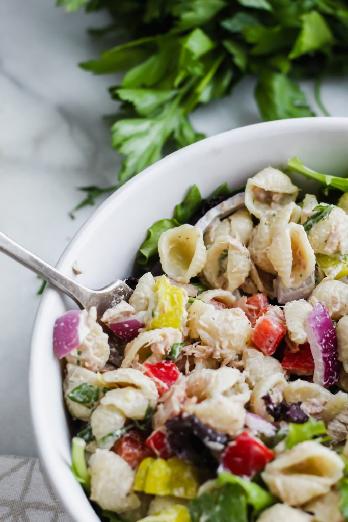 fork digging into a bowl of Loaded Tuna Pasta Salad
