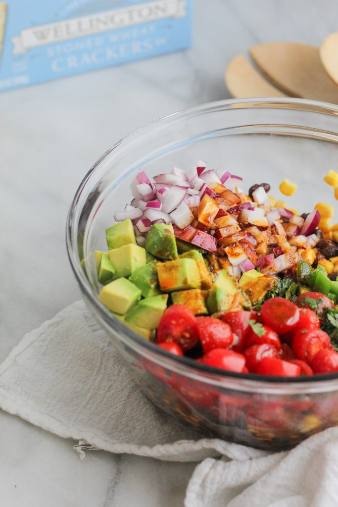ingredients with chili lime dressing on top in glass bowl