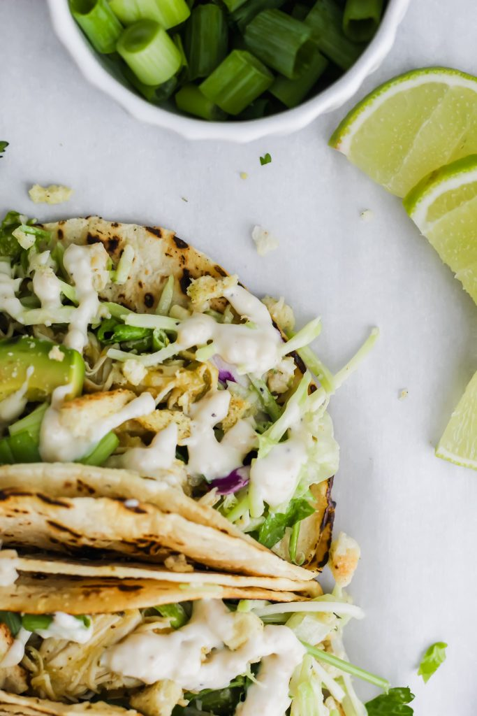 close up of Roasted Garlic Green Goddess Tacos with lime