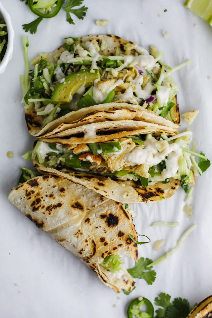 delicious Roasted Garlic Green Goddess Tacos with bite taken out of one