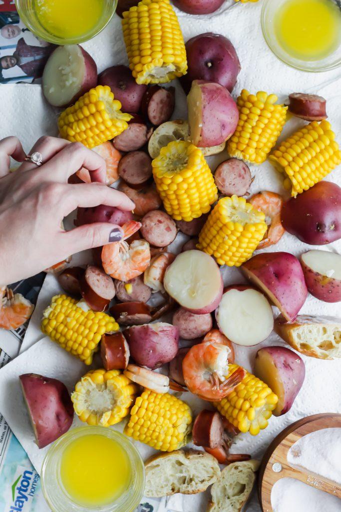 hand getting a shrimp