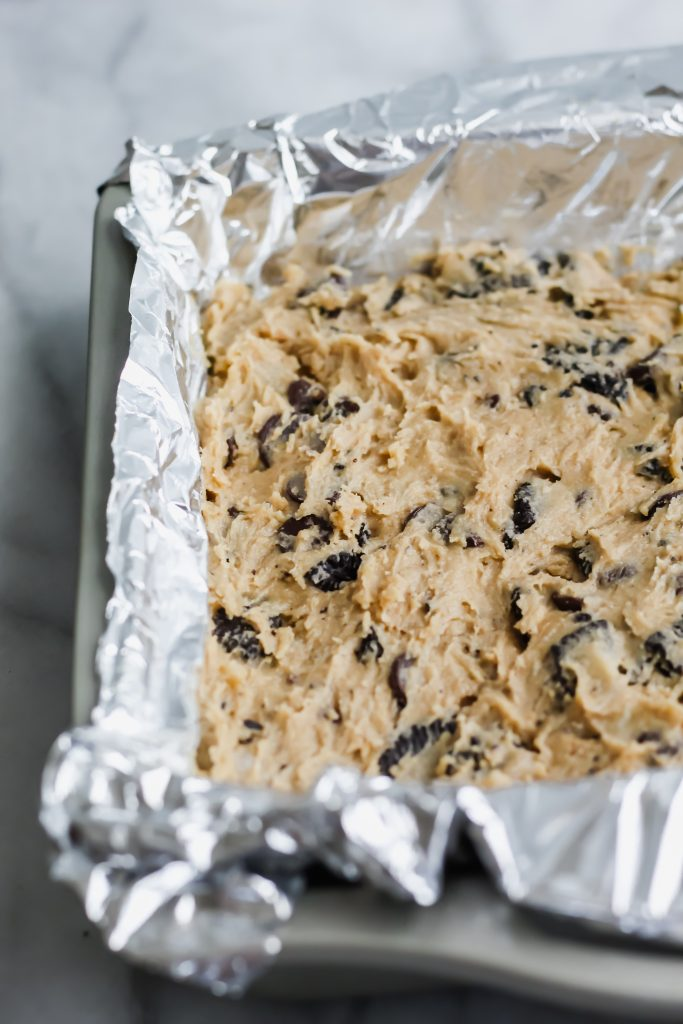 cookie dough in pan with foil