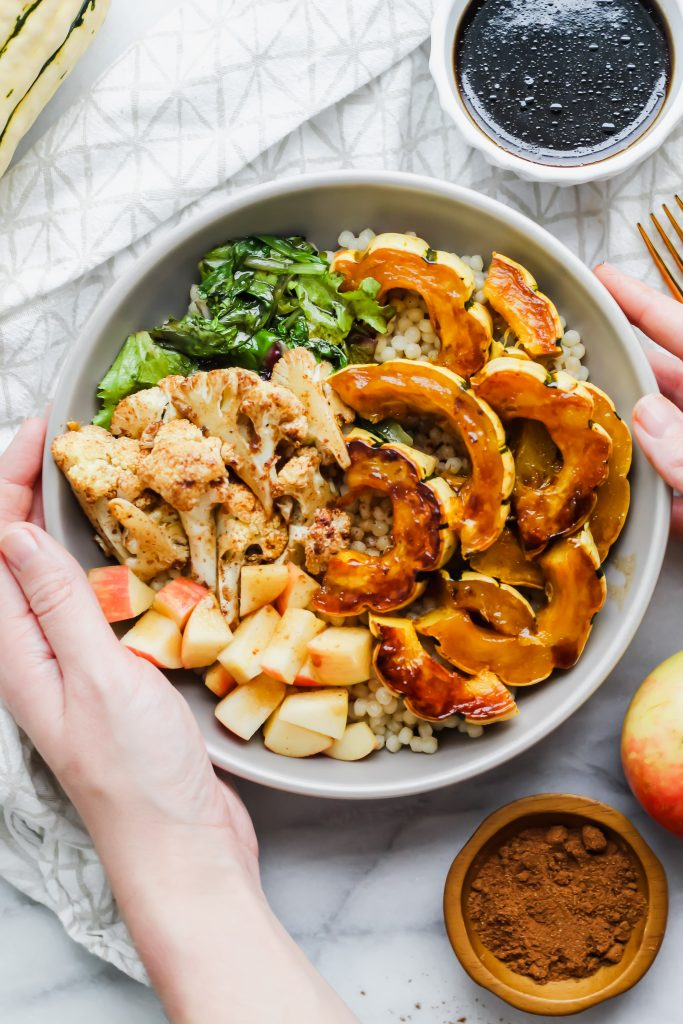 hands touching Loaded Maple Delicata Squash Bowl