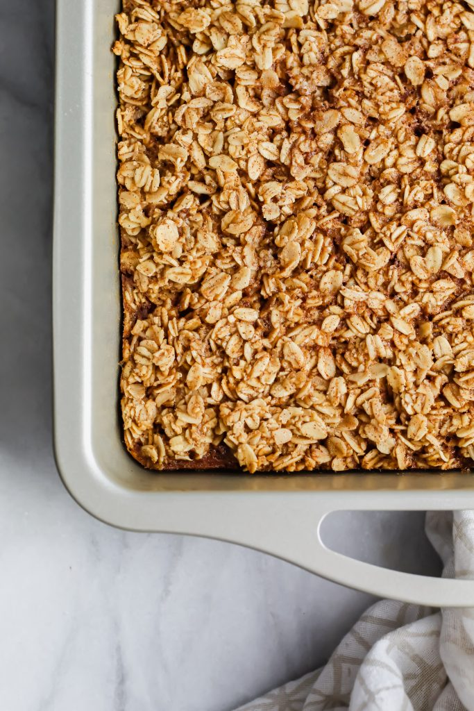 baked cinnamon roll oatmeal bars in pan