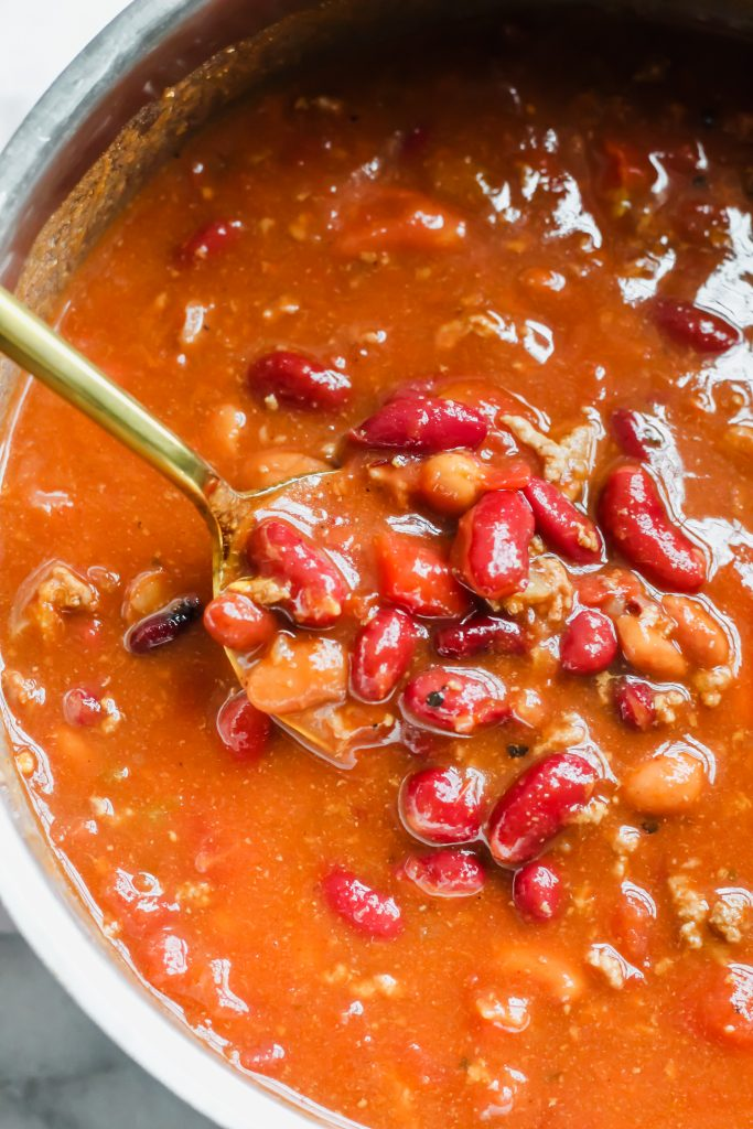 spoonful of chili in pot